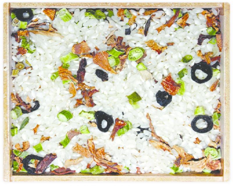 Risotto de rossinyols, espàrrecs i olives